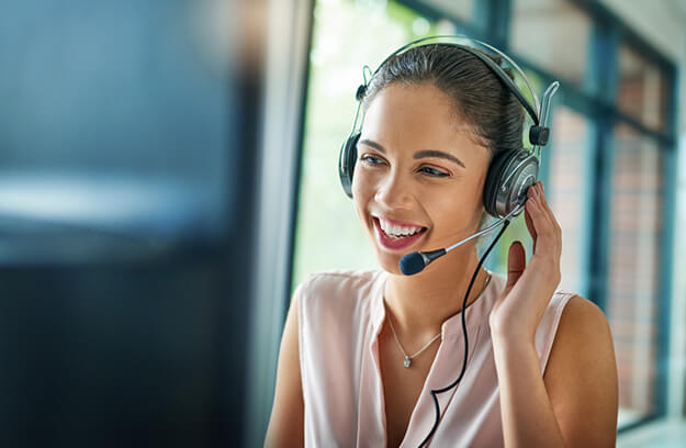 Smiling woman wearing headset