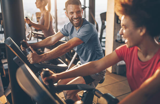 People in a gym using cardio machines