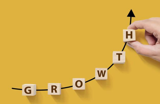 Letter blocks in an upward curve that reads growth