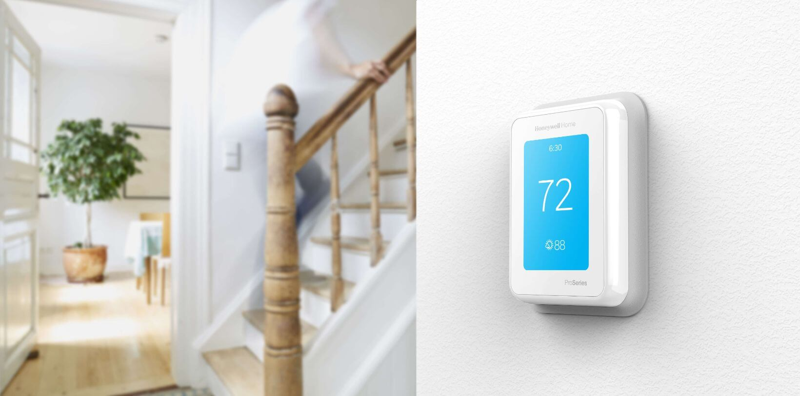 T10 thermostat next to a staircase