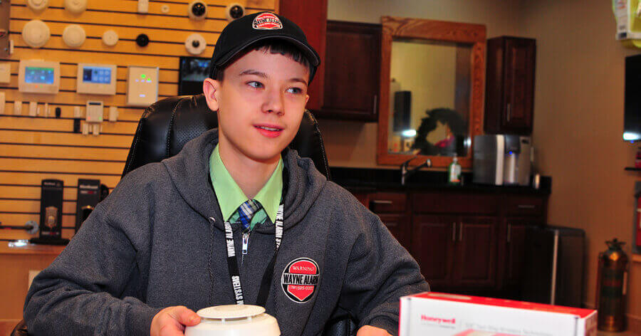 Logan Mayer with a Honeywell Home product