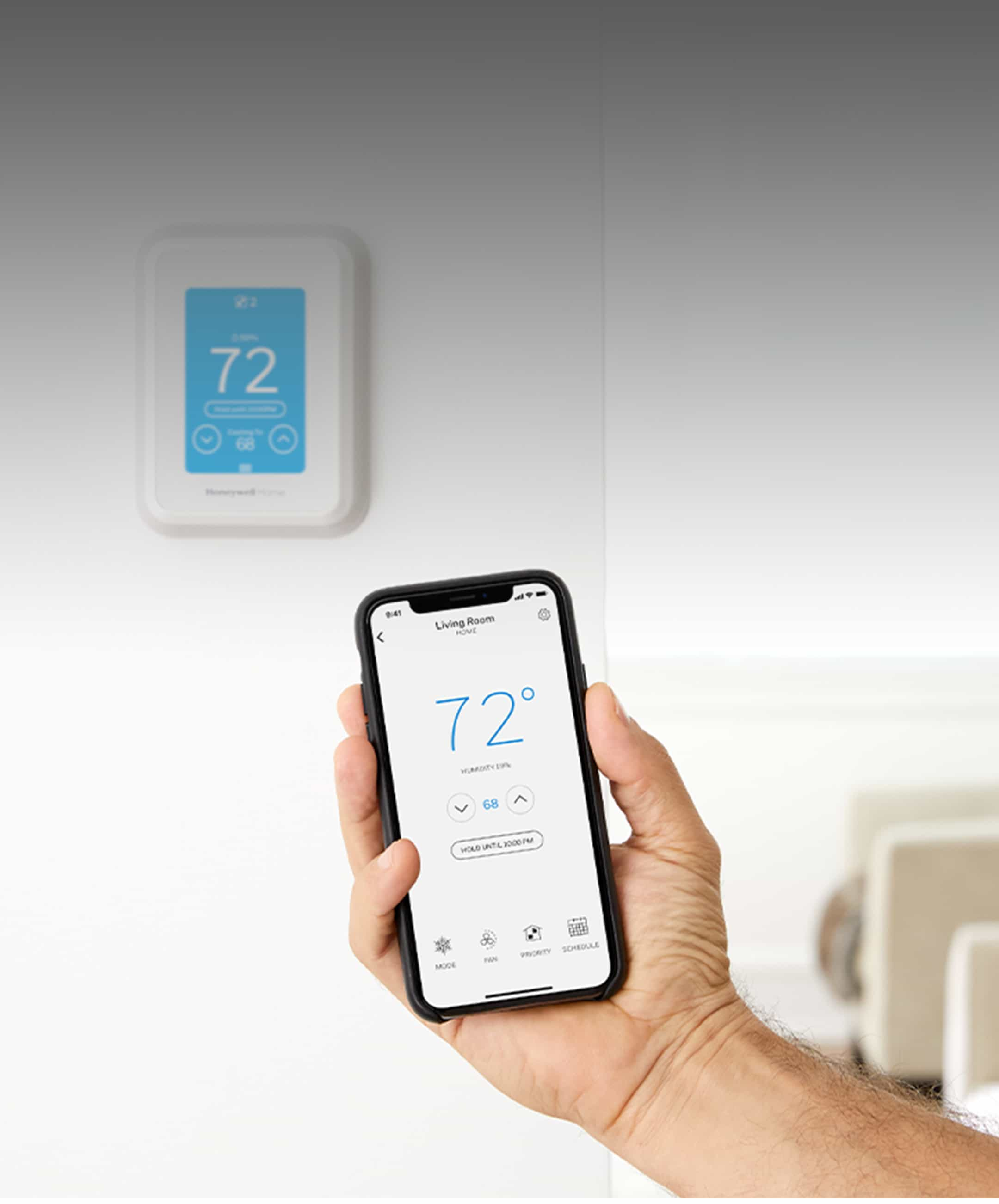 Phone that shows how Resideo smart thermostats adjust