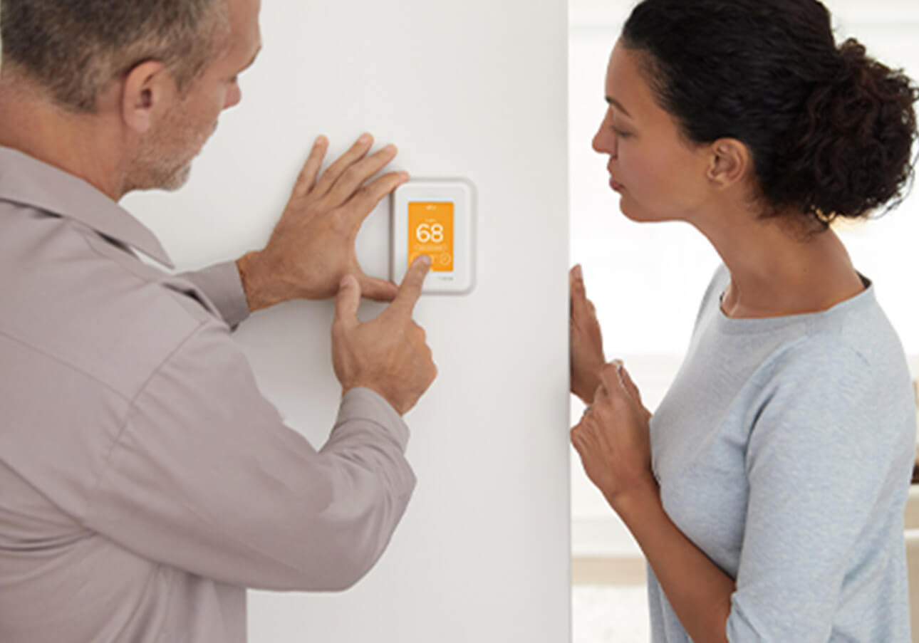 Pro helping homeowner choose smart thermostat