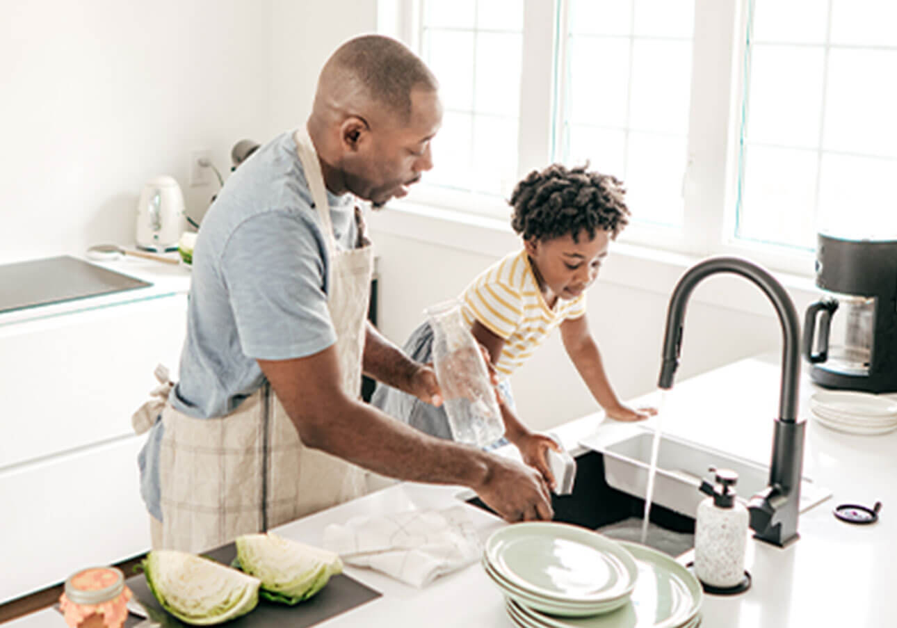Family using the sink to do dishes. Avoid water leaks to save money on your water bill.