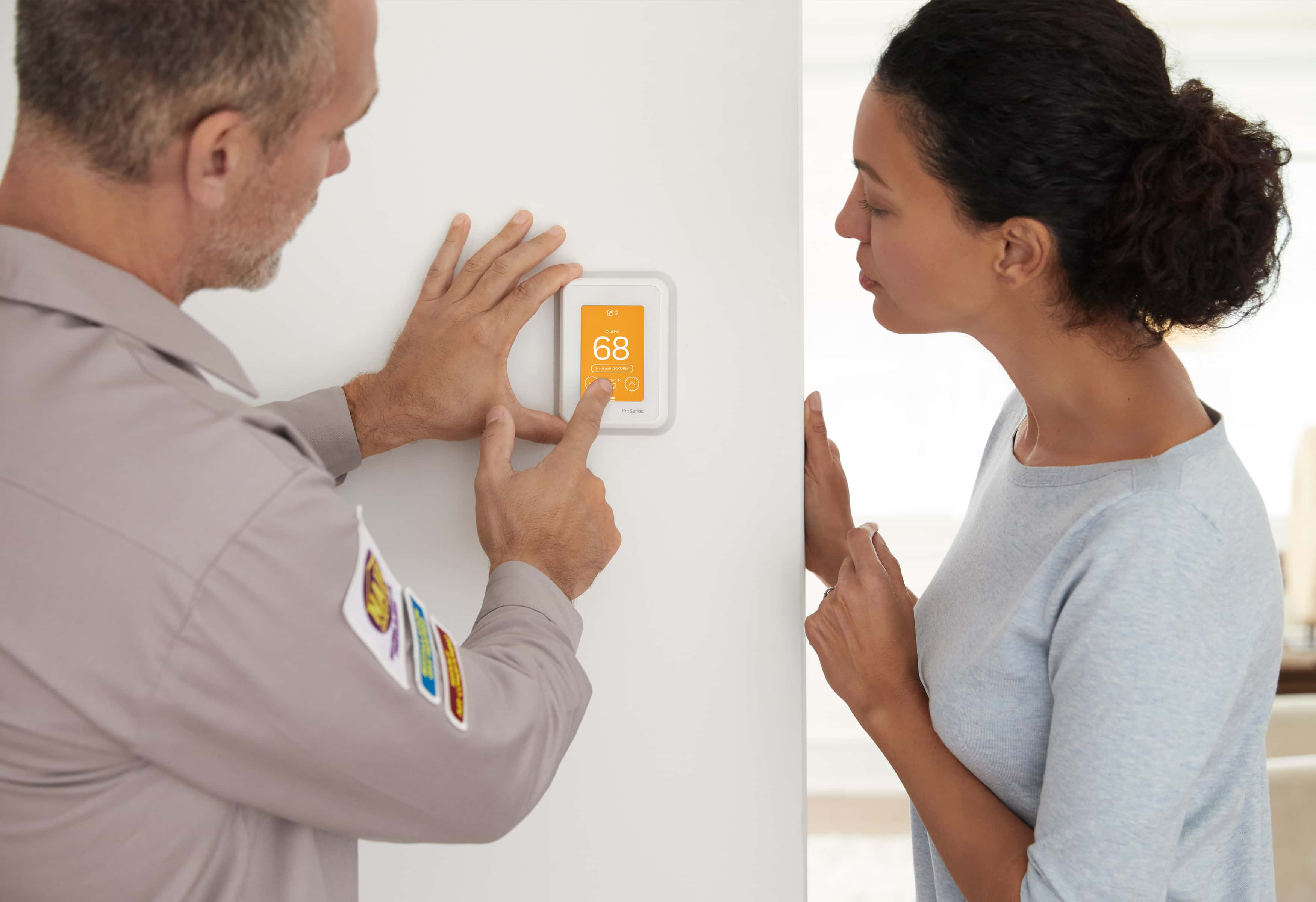 Contractor installing smart home energy product