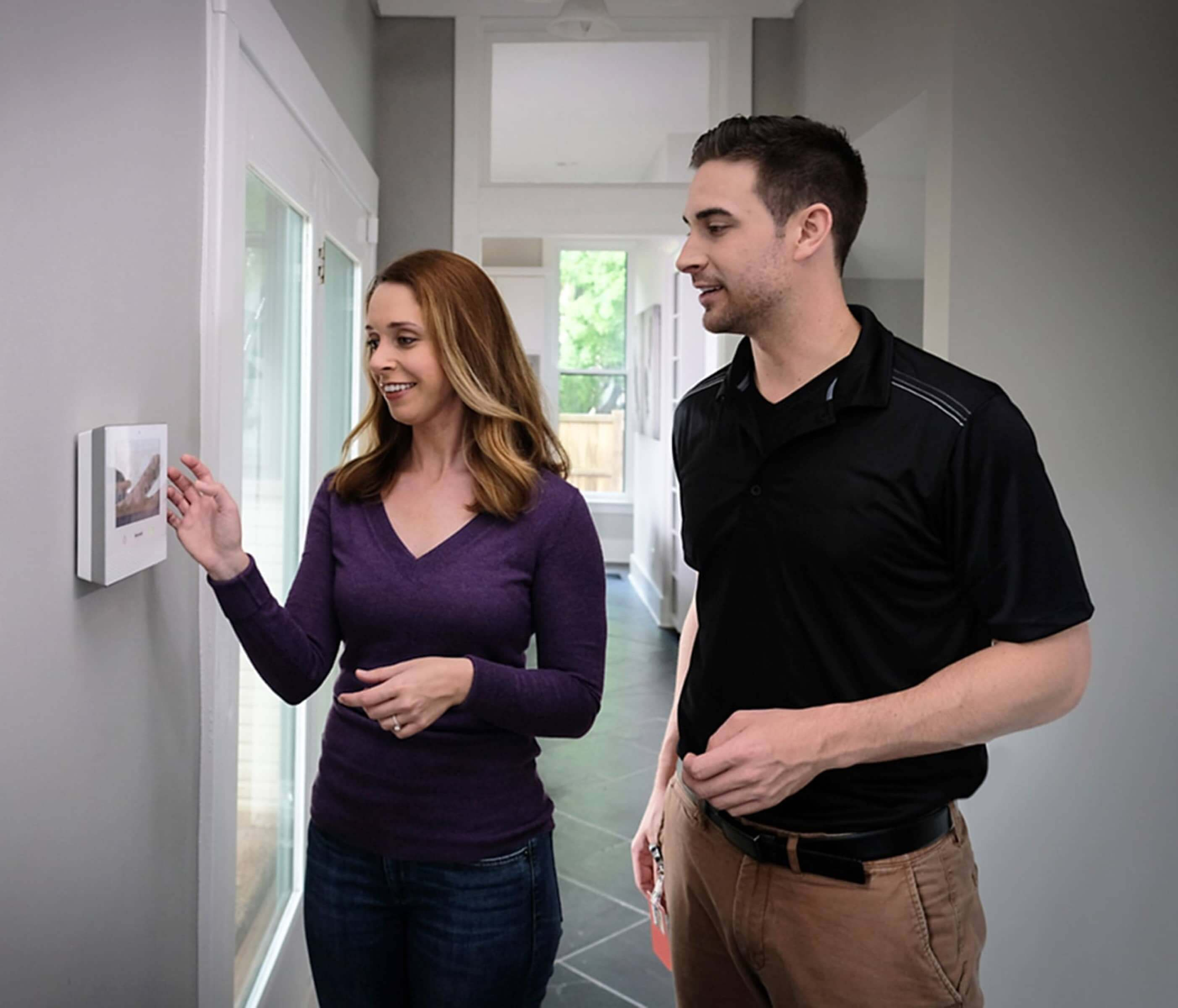 Contractor assisting homeowner with smart home automation installation