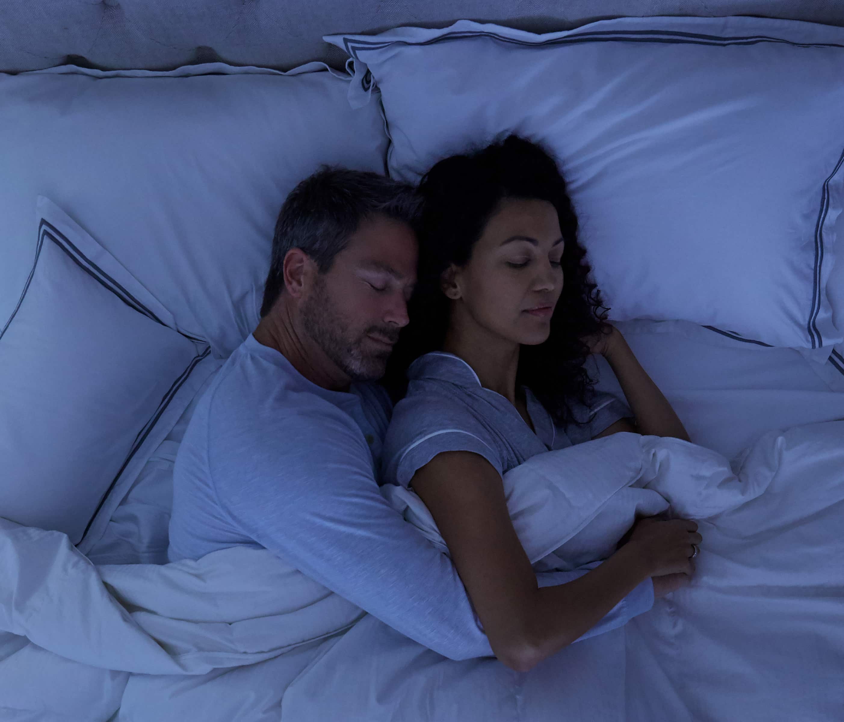 Couple sleeping securely in smart home security