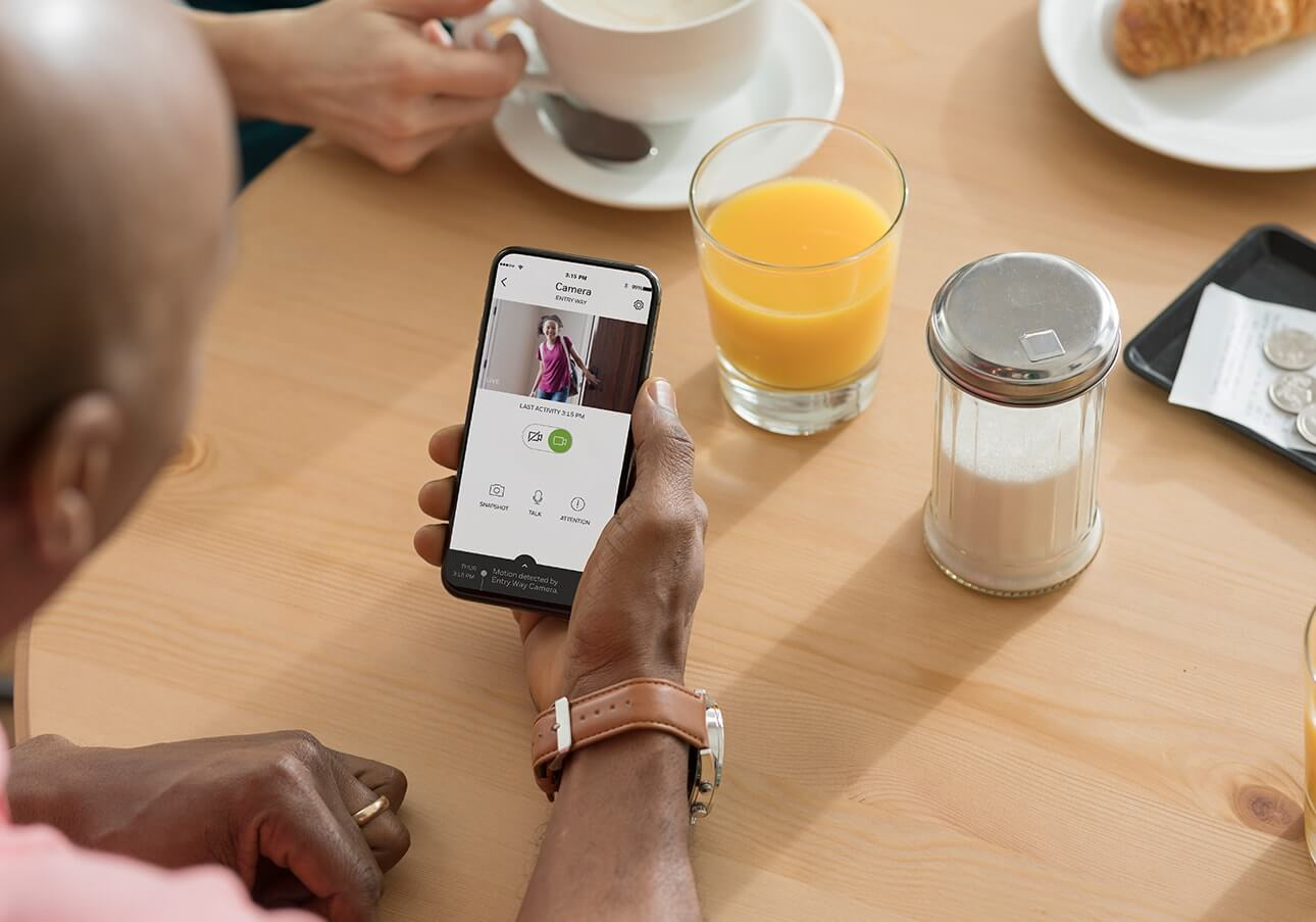 Checking smart home security sensor on smartphone app
