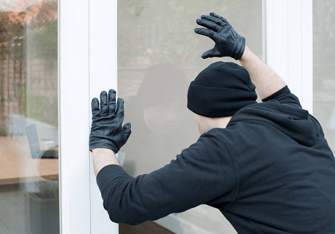 Burglar attempting to enter home smart home security