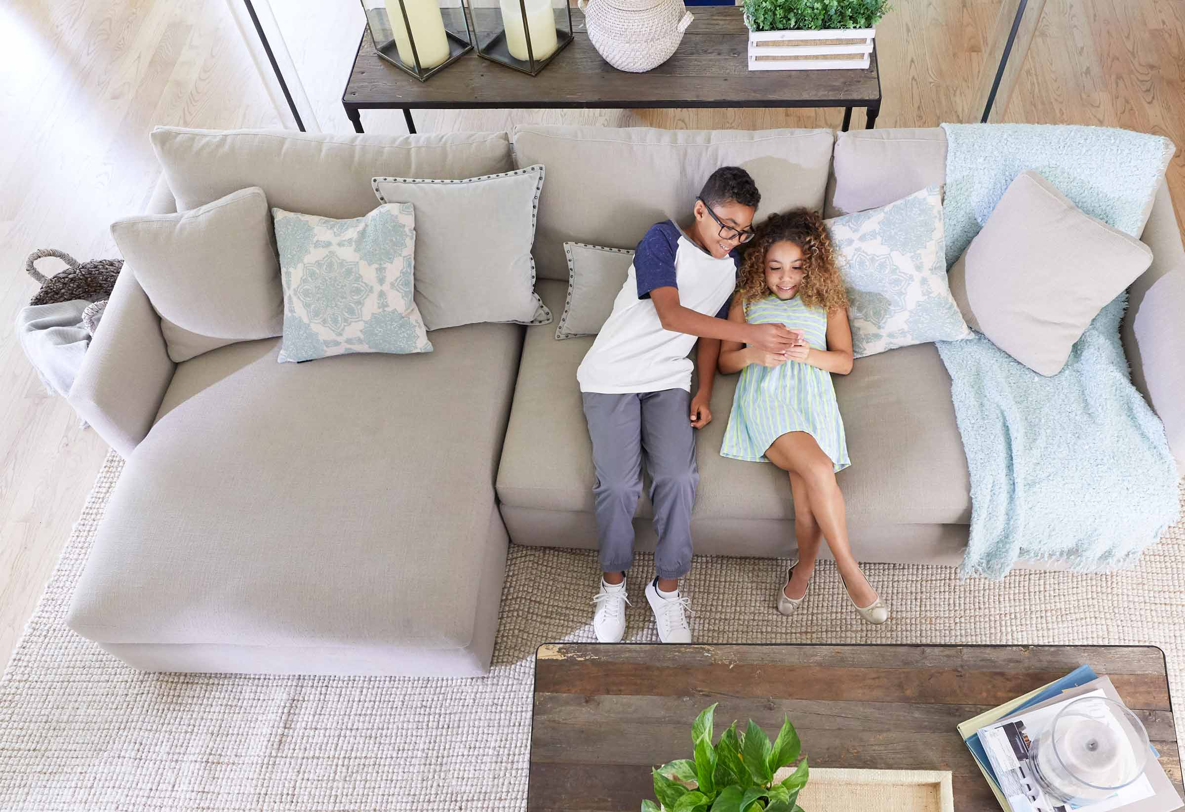 Children enjoying comfort in a living room